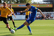 AFC Wimbledon midfielder Callum Reilly (33) with a shot on goal during the EFL Sky Bet League 1 match between AFC Wimbledon and Bristol Rovers at the Cherry Red Records Stadium, Kingston, England on 21 September 2019.