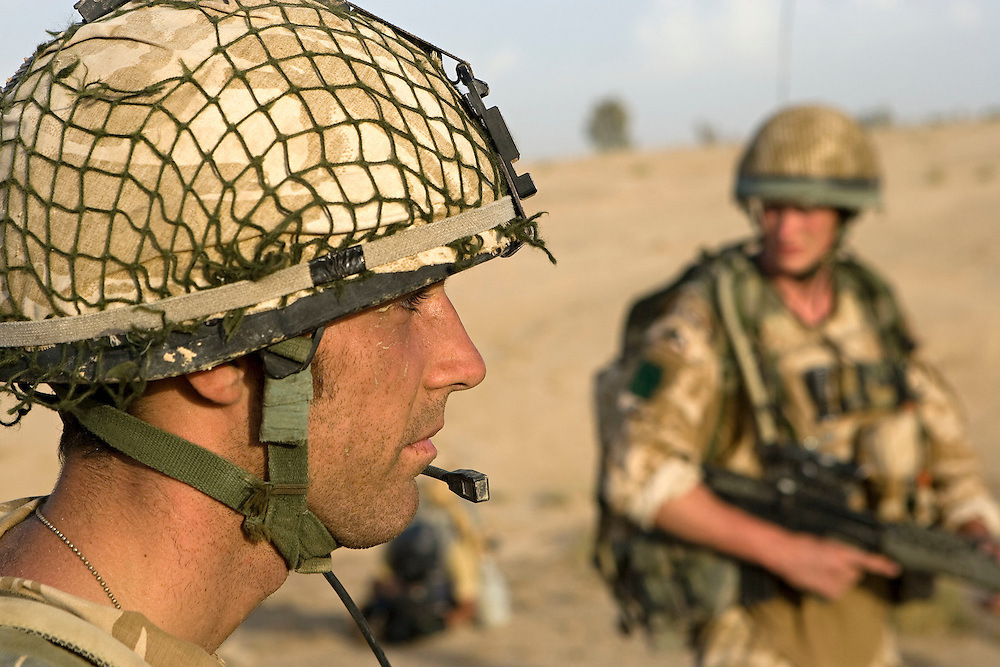 British soldiers of 3rd Battalion The Parachute Regiment patrol through the desert after being dropped by Chinook Ch-47 helicopters during an airborne assault as part of Operation 'Southern Beast'. Kandahar Province, Afghanistan on the 3rd of August 2008.