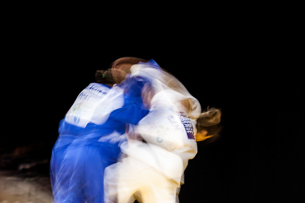 Catherine Roberge (in white) of Canada and Diana Chala (in blue) of Ecuador struggle for position in their women's judo -78kg class contest at the 2015 Pan American Games in Toronto, Canada, July 14,  2015.  AFP PHOTO/GEOFF ROBINS