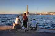 Fishing at night, the Venetian harbor, lighthouse, Chania, Crete, Greece