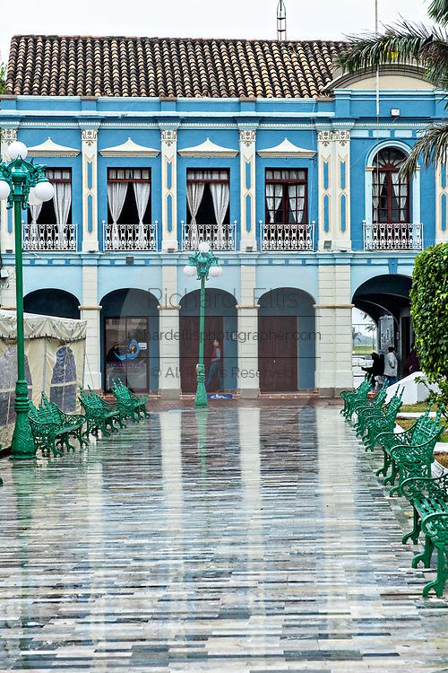 The brightly painted colonnaded style city hall along the Plaza Zaragoza in Tlacotalpan, Veracruz, Mexico. The tiny town is painted a riot of colors and features well preserved colonial Caribbean architectural style dating from the mid-16th-century.