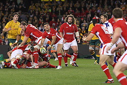 © Licensed to London News Pictures. 16/06/2012. Etihad Stadium, Melbourne Australia. Welsh player passes the ball out during the 2nd Rugby Test between Australia Wallabies Vs Wales . Photo credit : Asanka Brendon Ratnayake/LNP
