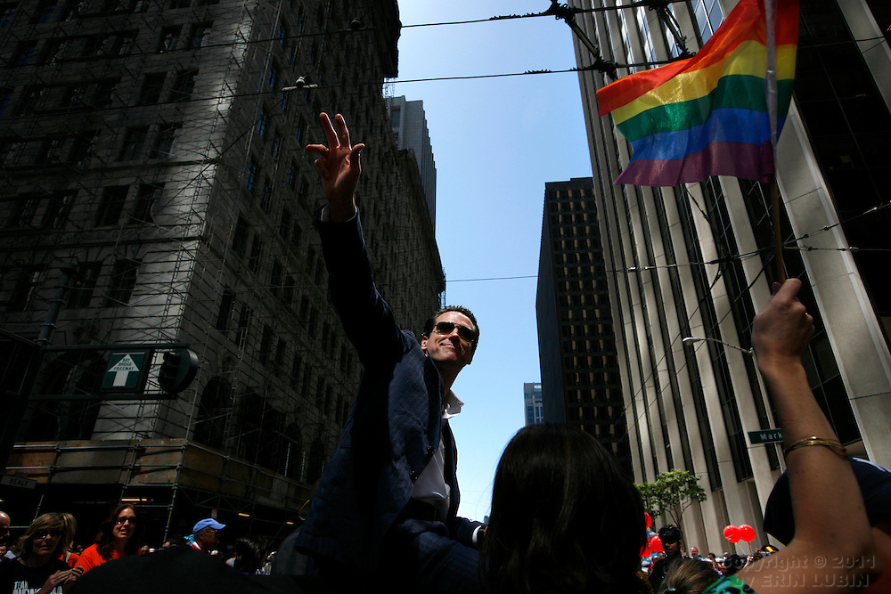 San Francisco Mayor, Gavin Newsom, waves to the crowds while riding  in the annual Gay Pride Parade in downtown San Francisco, Calif. Sunday, June 24, 2007...PHOTOGRAPHER: Erin Lubin/Bloomberg News.