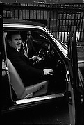 Mr. Neill Blaney, Minister for Local Government, takes the wheel to complete the new driving test, under one of the newly appointed examiners.<br /> 23.03.1964