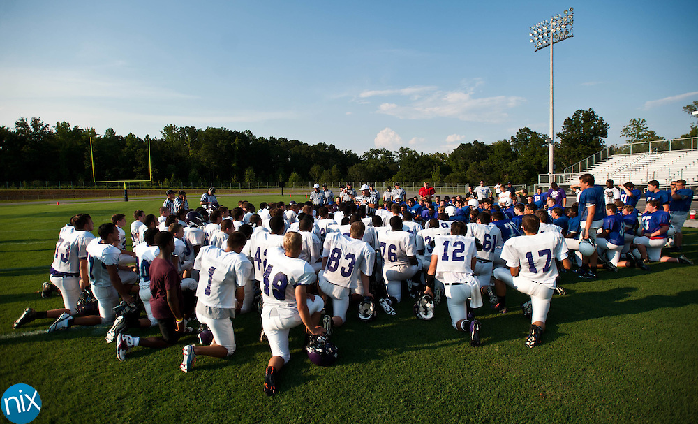 Cox Mill and Lake Norman get instruction from an official prior to a scrimmage at Cox Mill High School in Concord Friday night. (photo by James NIx)