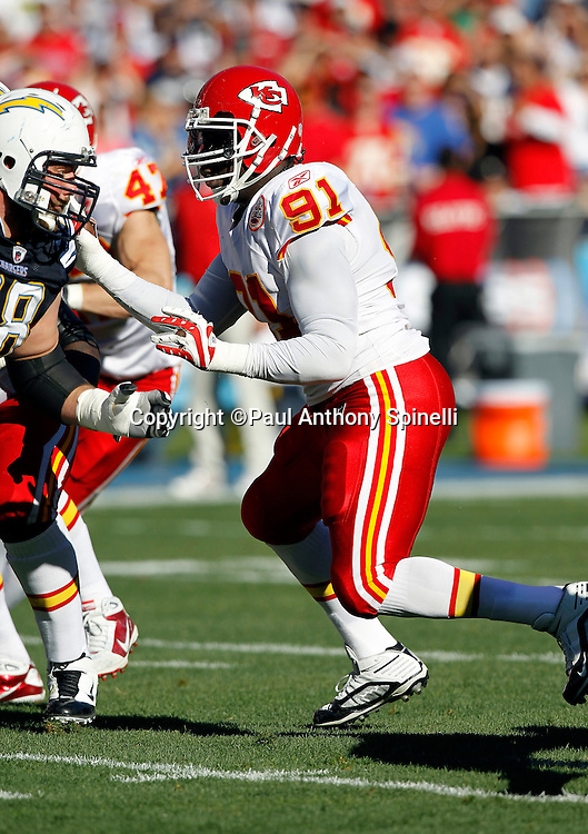 Kansas City Chiefs linebacker Tamba Hali (91) rushes the quarterback during the NFL week 14 football game against the San Diego Chargers on Sunday, December 12, 2010 in San Diego, California. The Chargers won the game 31-0. (©Paul Anthony Spinelli)