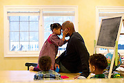 Shaun Alexander talks with his daughter Eden, 6 yrs old, at their home in Great Falls, VA, January 21, 2014.