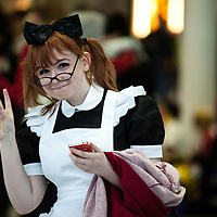 London, UK - 26 October 2012: a visitor poses for a picture during the Comic Con 2012 - MCM Expo - at the Excel where book fans, videogame lovers, anime devotees, cosplay wearers gather every year.