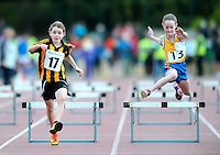 21 Aug 2016: Louisa Gilmore, left, Kilkenny, and Lisa Nicholas, from Clare, in the Girls U10 Hurdles final.  2016 Community Games National Festival 2016.  Athlone Institute of Technology, Athlone, Co. Westmeath. Picture: Caroline Quinn