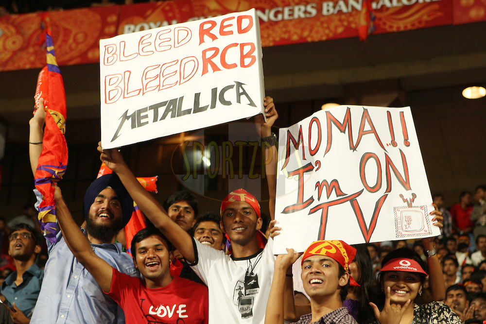 Spectators enjoying the atmosphere during match 21 of the the Indian Premier League ( IPL) 2012  between The Royal Challengers Bangalore and the Pune Warriors India held at the M. Chinnaswamy Stadium, Bengaluru on the 17th April 2012..Photo by Jacques Rossouw/IPL/SPORTZPICS