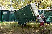 Philadelphia, Pennsylvania - September 16, 2015: Nilson Rodriguis and Hugo Cante offload portable toilets along the periphery of Benjamin Franklin Parkway in Philadelphia Wednesday September 16, 2015, in preparation for the hoards of people expected to show up for the World Meeting of Families concert and the Pope's visit.<br /> <br /> Scott Mirkin's company ESM is heading the production of The World Meeting Of Families and Pope Francis's visit to Philadelphia this Fall. The events will take place along the Benjamin Franklin Parkway.<br /> <br /> CREDIT: Matt Roth for The New York Times<br /> Assignment ID: 30179397A