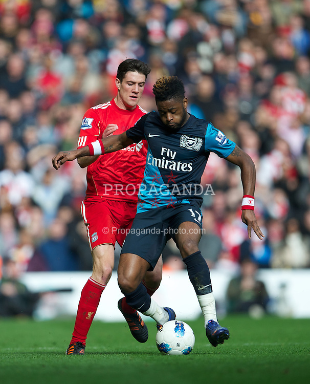 LIVERPOOL, ENGLAND - Saturday, March 3, 2012: Liverpool's Martin Kelly in action against Arsenal's Alexandre Dimitri Song Billong during the Premiership match at Anfield. (Pic by David Rawcliffe/Propaganda)
