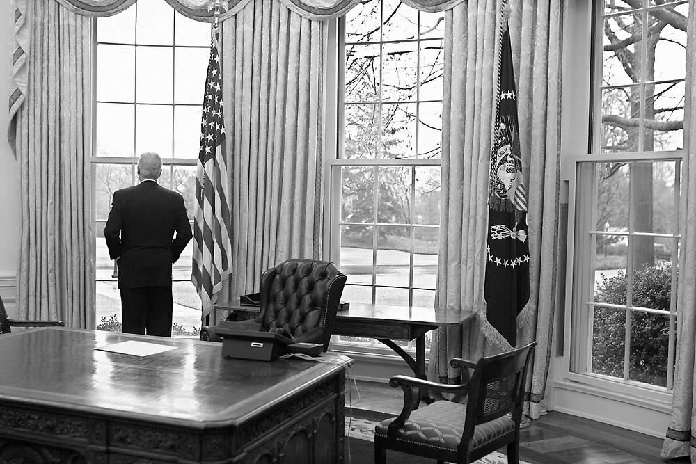 President Clinton takes one final look before exiting the Oval Office for the last time.  the only things on his desk are the phone and a note to incoming President Bush.