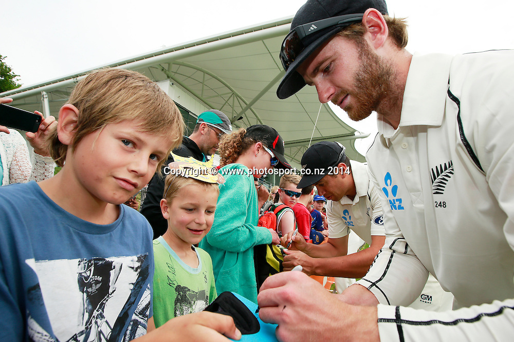 Kane Williamson of the Black Caps signs autographs following play on Day 2 of the boxing Day Cricket Test Match between the Black Caps v Sri Lanka at Hagley Oval, Christchurch. 27 December 2014 Photo: Joseph Johnson / www.photosport.co.nz