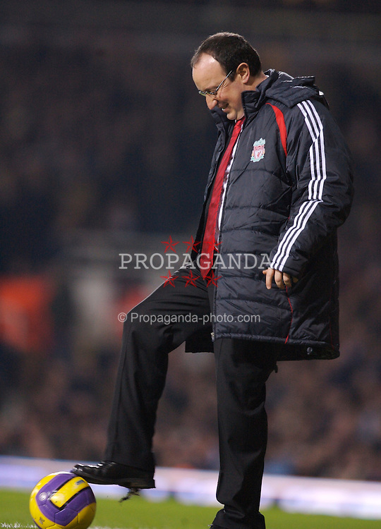 London, England - Tuesday, January 30, 2007: Liverpool's manager Rafael Benitez is all smiles after taking a tumble during the Premiership match against West Ham United  at Upton Park. (Pic by David Rawcliffe/Propaganda)