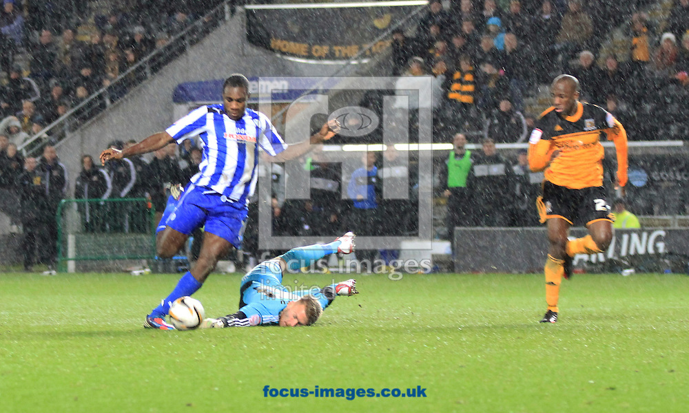 Picture by Richard Gould/Focus Images Ltd +447814 482222.12/01/2013.Mark Oxley GK of Hull City is rounded by Michail Antonio of Sheffield Wednesday to make it 3 -1 during the npower Championship match at the KC Stadium, Kingston upon Hull.