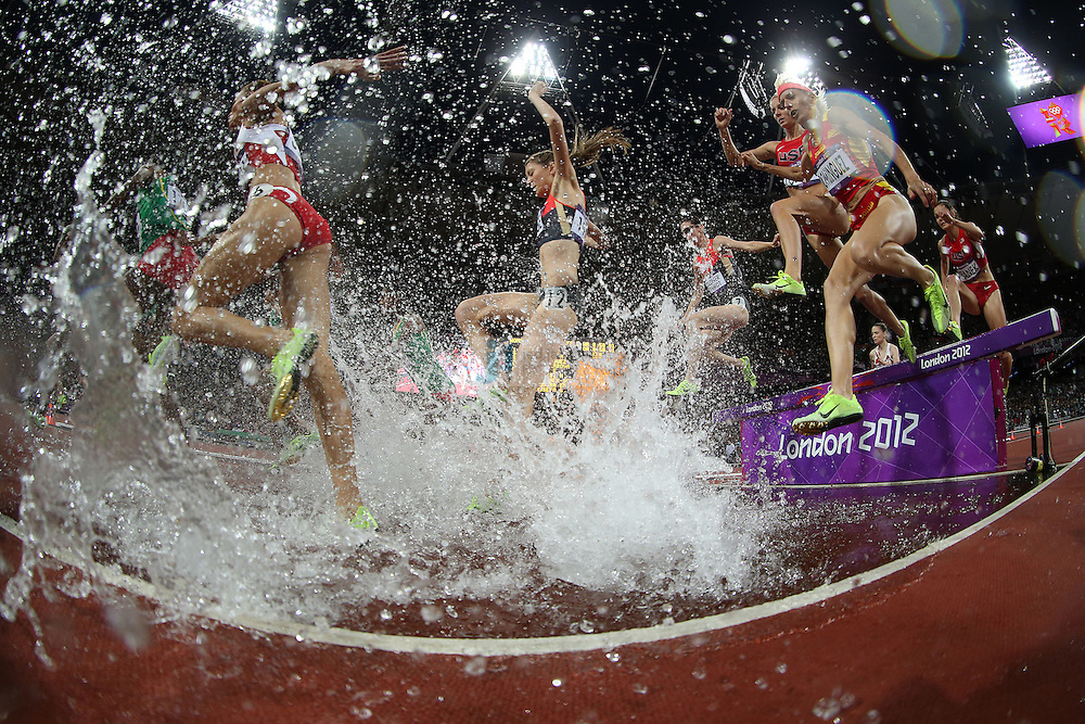 Runner jump in the water during the 3000m steeplechase final at track and field at the Olympic Stadium during day 10 of the London Olympic Games in London, England, United Kingdom on August 3, 2012..(Jed Jacobsohn/for The New York Times)..
