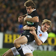 Conrad Smith, New Zealand, is tackled by Aurelien Rougerie, France,   during the New Zealand V France Final at the IRB Rugby World Cup tournament, Eden Park, Auckland, New Zealand. 23rd October 2011. Photo Tim Clayton...