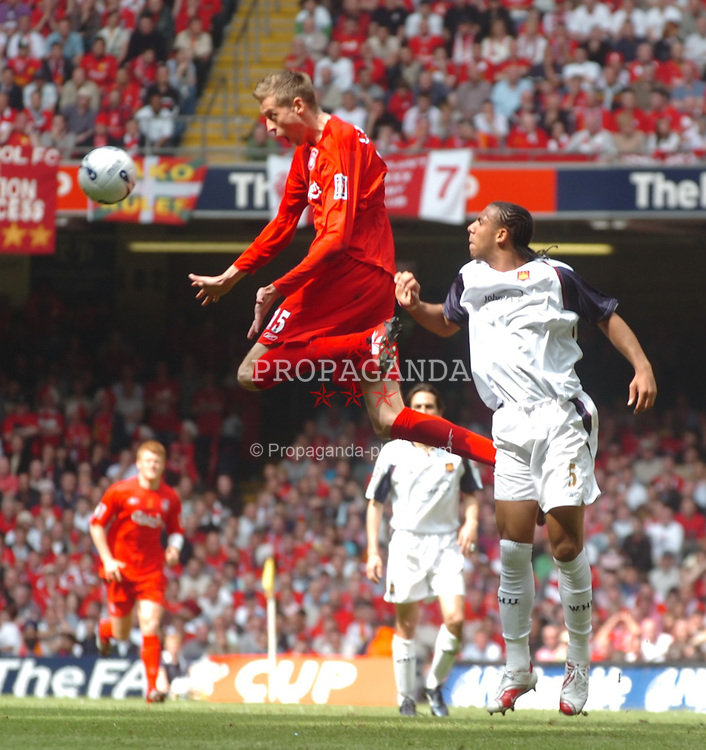 CARDIFF, WALES - SATURDAY, MAY 13th, 2006: Liverpool's Peter Crouch and West Ham United's Anton Ferdinand during the FA Cup Final at the Millennium Stadium. (Pic by Jason Roberts/Propaganda)