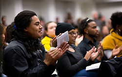 Ray Taula '18, reacts to comments by panilist at a forum discussion of issues surrounding deaths of African-Americans by police and is sponsored by the Diversity Center, Women's Center and CCES held in the Scandinavian Center at PLU on Thursday, Dec. 4, 2014. (PLU Photo/John Froschauer)