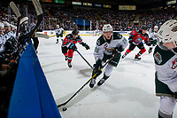 KELOWNA, BC - SEPTEMBER 28:  Dillon Hamaliuk #22 of the Kelowna Rockets stick checks Reece Vitelli #26 of the Everett Silvertips as he skates with the puck in front of the Everett bench at Prospera Place on September 28, 2019 in Kelowna, Canada. (Photo by Marissa Baecker/Shoot the Breeze)