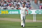 Neil Wagner receives the ball at the top of his mark during the Specsavers County Champ Div 1 match between Lancashire County Cricket Club and Nottinghamshire County Cricket Club at the Emirates, Old Trafford, Manchester, United Kingdom on 17 April 2016. Photo by Simon Trafford.