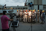 Miners are interviewed during the occupation of the coal mine Carbosulcis in Nuraxi Figus village undertaken to protest against its foreseen closure.