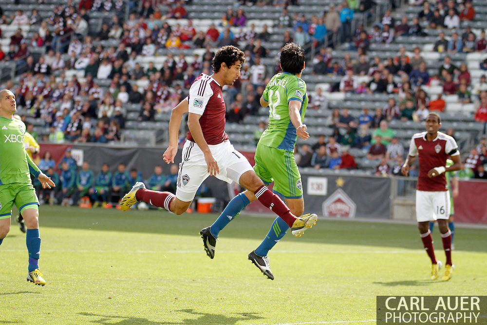 April 20th, 2013 Commerce City, CO - Colorado Rapids midfielder Tony Cascio (14) elevates in front of the goal in an attempt at a Rapids corner kick in first half action of the MLS match between the Seattle Sounders FC and the Colorado Rapids at Dick's Sporting Goods Park in Commerce City, CO