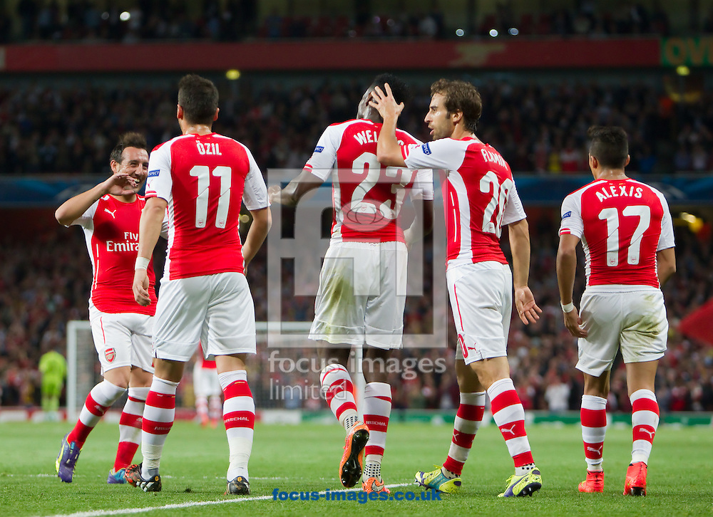 Danny Welbeck of Arsenal is congratulated by team-mates after Scoring against Galatasaray during the UEFA Champions League match at the Emirates Stadium, London<br /> Picture by John Rainford/Focus Images Ltd +44 7506 538356<br /> 01/10/2014