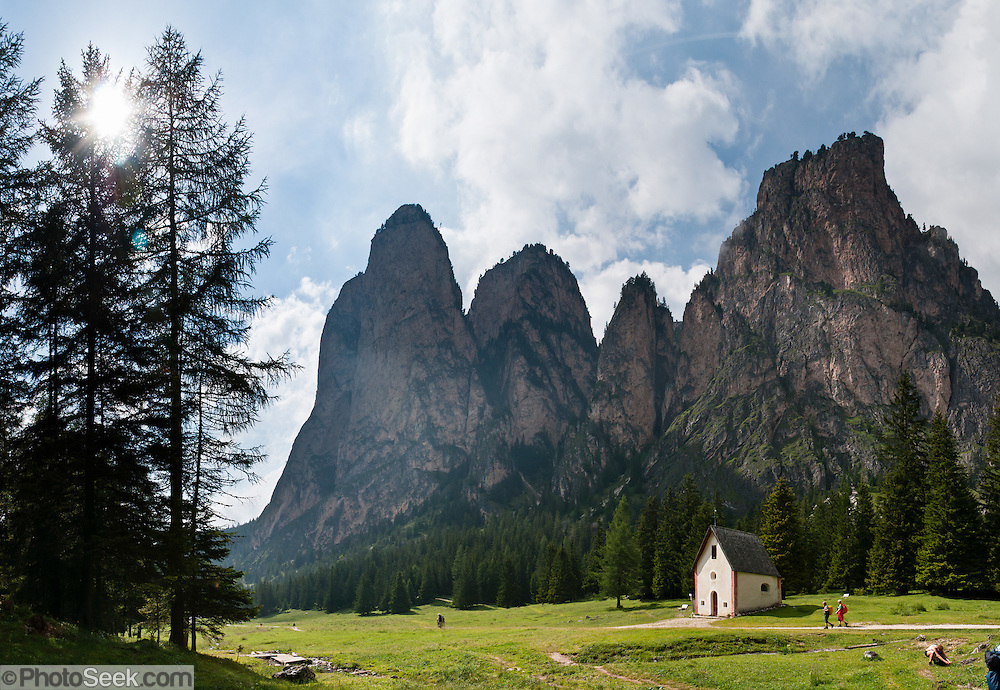 Saint Sylvester's Chapel (San Silvestro) in Vallunga is dedicated to the patron saint of cattle and contains 300-year-old frescoes depicting the life of Jesus. Walk through the beautiful, deeply glaciated, U-shaped valley of Vallunga/Langental in Puez-Geisler Nature Park (Italian: Parco naturale Puez Odle; German: Naturpark Puez-Geisler) near Selva di Val Gardena, in the Dolomites, Italy, Europe. The mostly Ladin-speaking town of Sëlva Gherdëine (German: Wolkenstein in Gröden; Italian: Selva di Val Gardena) is in Südtirol/South Tyrol/Alto Adige, in the Dolomiti, part of the Southern Limestone Alps. Panorama stitched from 4 overlapping photos.