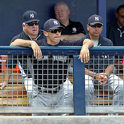 March 21, 2012; Port Charlotte, FL, USA; New York Yankees manger Joe Girardi watches from the dugout during the third inning of a spring training game against the Tampa Bay Rays at Charlotte Sports Park.  Mandatory Credit: Derick E. Hingle-US PRESSWIRE