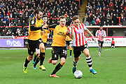 Archie Collins (27) of Exeter City battles for possession with George Maris (10) of Cambridge United during the EFL Sky Bet League 2 match between Exeter City and Cambridge United at St James' Park, Exeter, England on 11 January 2020.