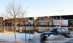 © Licensed to London News Pictures. 26/12/2013<br /> Angel Lane in Tonbridge is badly flooded today (26.12.2013) with the local Sainsburys car Park totally under water.<br /> Boxing day flooding in Kent.<br /> Large parts of Kent are still flooded due to heavy rain with more bad weather expected.<br /> Photo credit :Grant Falvey/LNP