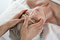 Senior woman having head massage