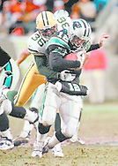 (Published caption 12/15/97) Packers safety LeRoy Butler sacks Panthers' Kerry Collins in the second quarter.  Butler also held tight end Wesley Walls to one catch.