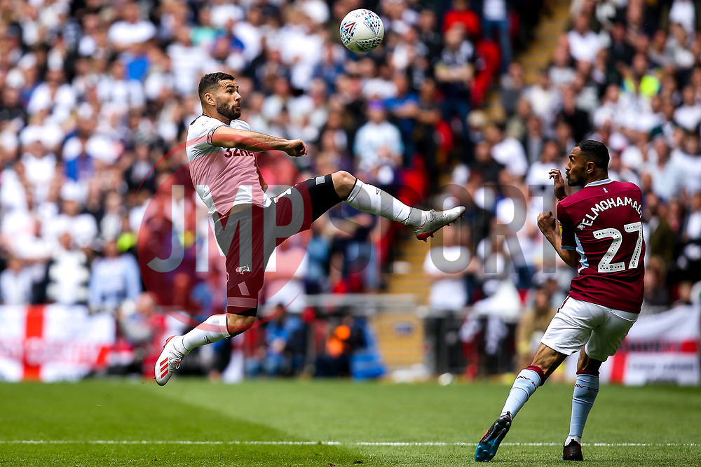 Bradley Johnson of Derby County beats Ahmed Elmohamady of Aston Villa to the ball - Mandatory by-line: Robbie Stephenson/JMP - 27/05/2019 - FOOTBALL - Wembley Stadium - London, England - Aston Villa v Derby County - Sky Bet Championship Play-off Final