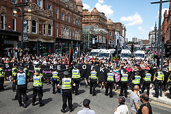 """© Licensed to London News Pictures . 07/07/2018 . Leeds , UK . Anti-fascist counter protesters obstruct Boar Lane in order to block an anti-Islam march by supporters of jailed EDL founder Tommy Robinson , including those from the """" Yorkshire Patriots """" and """" First for Britain """" , in Leeds City Centre . Robinson ( real name Stephen Yaxley-Lennon ) was convicted of Contempt of Court in May 2018 after committing a second offence , whilst serving a suspended sentence for the same crime . Photo credit : Joel Goodman/LNP"""