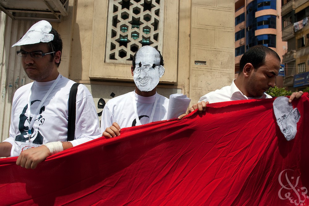 Supporters of Egyptian Nobel Peace laureate and former UN atomic watchdog chief, Mohamed ElBaradei  wear masks of his likeness outside a local mosque where ElBaradei came for Friday noon prayers April 2, 2010 in the Egyptian Nile delta town of El Mansoura just over a hundred kilometers north of the Egyptian capital Cairo. ElBaradei is thought to be a possible candidate to run against Egyptian President Hosni Mubarak in the 2011 presidential election, although he has not made a formal declaration as of yet.