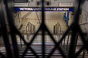 Looking through closed station gates at an empty Victoria station during the 24hr tube strike affecting Londoners and passengers throughout the capital, on 9th January 2017, London, England. The industrial action, coordinated by the Rail, Maritime and Transport (RMT) union and the Transport Salaried Staff's Association (TSSA), closed the vast majority of underground lines.