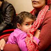 Greece with Doctors of the World (Medecins du monde). Hellenic Seaways ferry from Lesvos to Chios to Athens, taken by refugees. Doctors of the World have a clinic on board with a doctor, nurse, interpreters and social workers. Waiting to see the doctor.