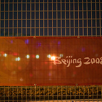 BEIJING, AUGUST 5 :  a banner advertising the 2008 Olympics is seen outside the National Stadium.