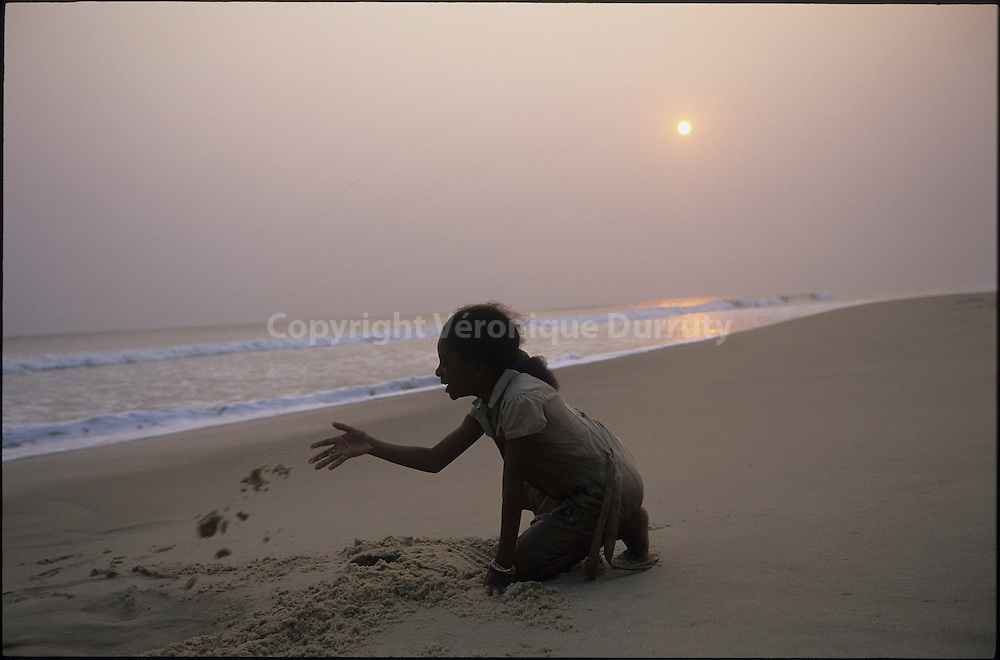 CHILD PLAYING WITH THE SAND, PONIT NOIRE BEACH, CONGO