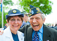 American Legion Post 1282 Auxiliary member Betty Tucker (left) and Legionnaire (right) at the Merrick Memorial Day Parade  and Ceremonies on Monday, May 28, 2012, on Long Island, New York, USA. America's war heroes are honored on this National Holiday.