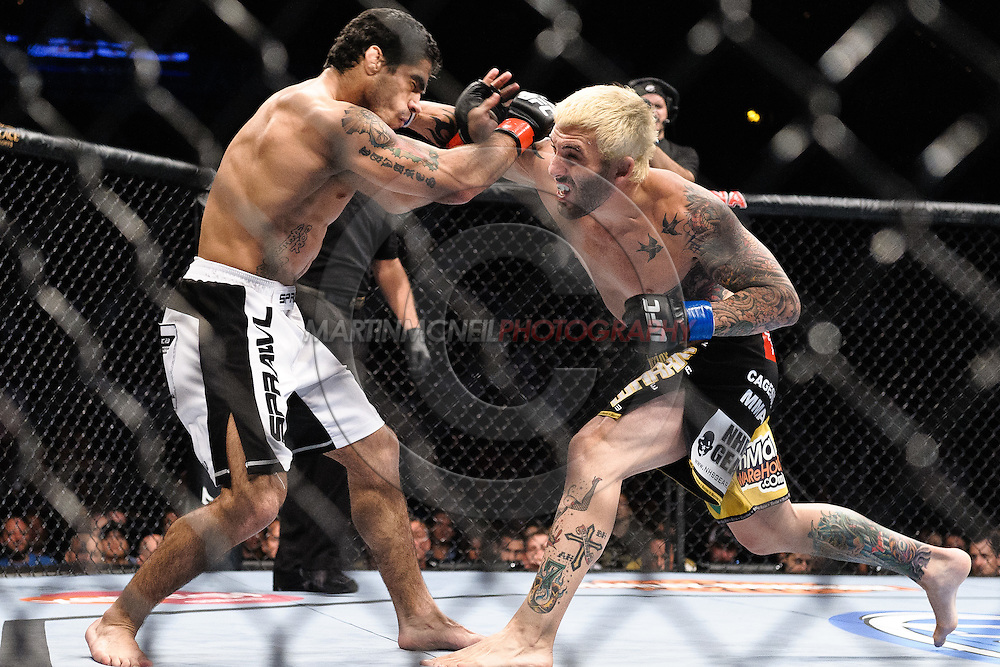 "ATLANTA, GEORGIA, SEPTEMBER 6, 2008: Thiago Tavares (left) failes to block a punch from Kurt Pellegrino during ""UFC 88: Breakthrough"" inside Philips Arena in Atlanta, Georgia on September 6, 2008"