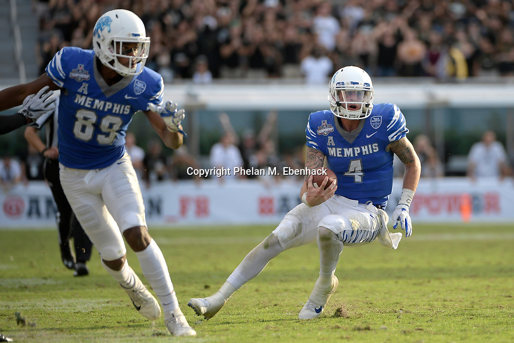 Memphis quarterback Riley Ferguson (4) scrambles for yardage behind wide receiver Phil Mayhue (89) during the second half of the American Athletic Conference championship NCAA college football game against Central Florida Saturday, Dec. 2, 2017, in Orlando, Fla. Central Florida won 62-55. (Photo by Phelan M. Ebenhack)
