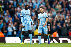 Yaya Toure and Sergio Aguero of Manchester City look dejected after Mame Biram Diouf of Stoke scores a goal to give his side a 0-1 lead - Photo mandatory by-line: Rogan Thomson/JMP - 07966 386802 - 30/08/2014 - SPORT - FOOTBALL - Manchester, England - Etihad Stadium - Manchester City v Stoke City - Barclays Premier League.