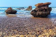 Rocks in the sea at Legzira Beach, Atlantic Ocean, Morocco.