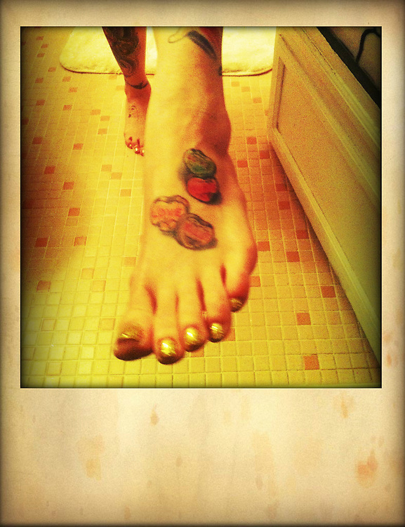 Tattooed feet on bathroom floor cellphone photography,Iphone pictures,smartphone pictures