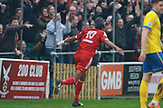 Whitehawk striker Danny Mills celebrates after opening the scoring during the The FA Cup match between Whitehawk FC and Lincoln City at the Enclosed Ground, Whitehawk, United Kingdom on 8 November 2015. Photo by Bennett Dean.