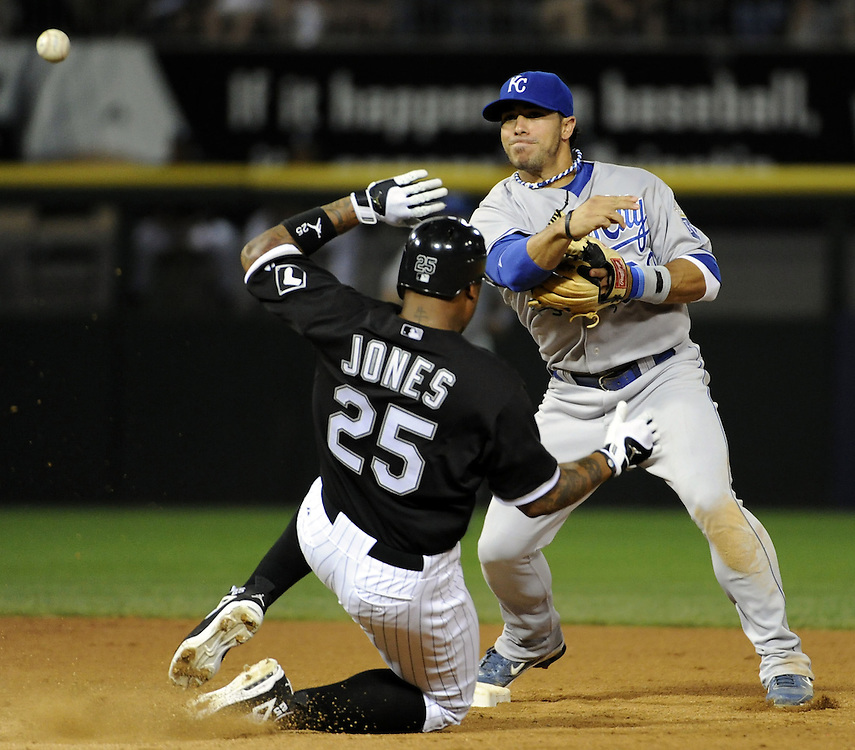 CHICAGO - JULY 09:  Mike Aviles #30 of the Kansas City Royals turns a double play over the sliding Andruw Jones #25 of the Chicago White Sox on July 9, 2010 at U.S. Cellular Field in Chicago, Illinois.  The White Sox defeated the Royals 8-2.  (Photo by Ron Vesely)